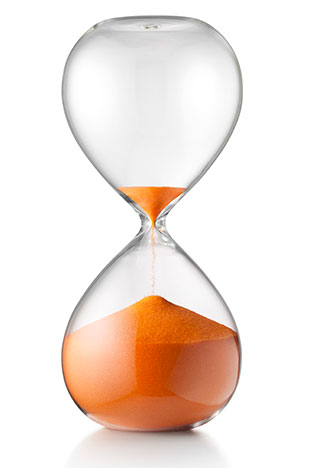 Hourglass with sand running low to depict that early infections can become dormant and resurface years later